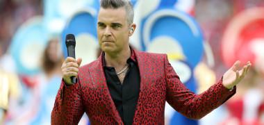 Gestul obscen făcut de Robbie Williams la ceremonia de deschidere a...