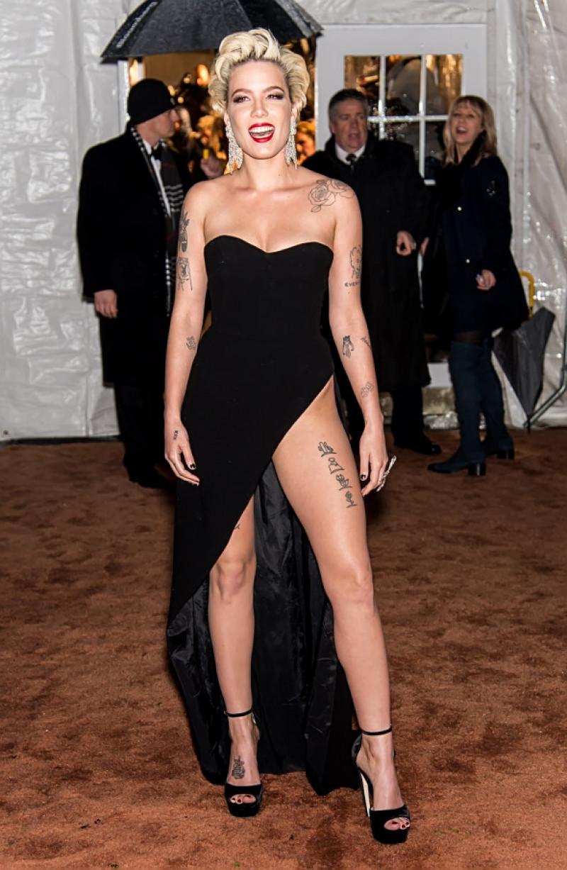 Halsey shows black underwear as she arrives at amfAR Gala New York