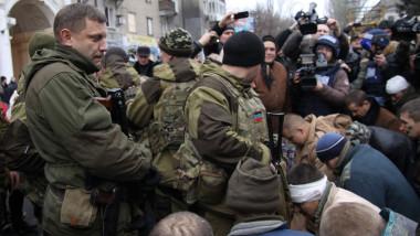prizonieri ucraieni ingenunchiati - 7239841-AFP Mediafax Foto-ALEKSANDER GAYUK