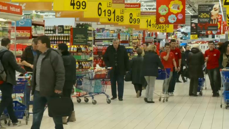 oameni magazin cumparaturi