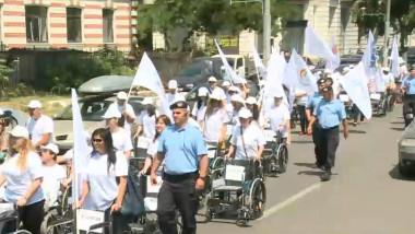 mars persoane dizabilitati scaun rotile