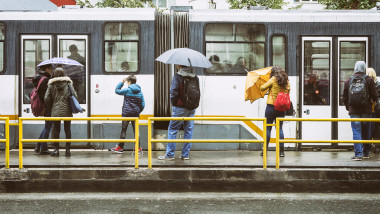 Waiting for the tram in the rain