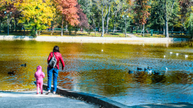Mother and daughter enjoying the ducks and foliage