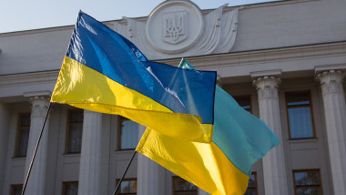 Ukrainian flags are developing near the parliament building. Ukraine