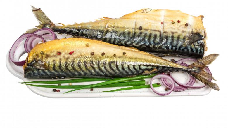 smoked mackerel on white cutting board isolated on white background