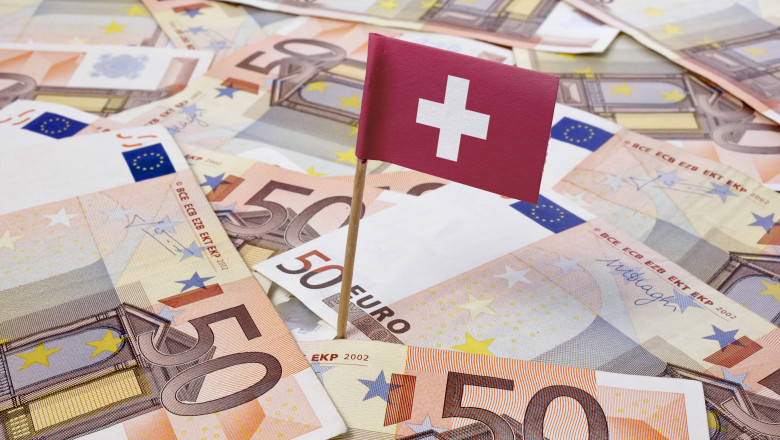 Flag of Switzerland sticking in 50 Euro banknotes.(series)