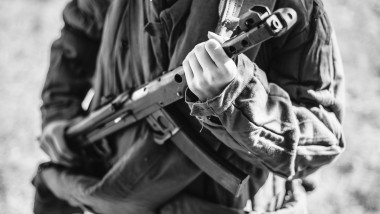 Woman Re-enactor Dressed As World War Ii Soviet Russian Red Army Soldier Holding World War II Weapon Submachine Gun Pps-43. WWII WW2 Russian Ammunition. Photo In Black And White Colors