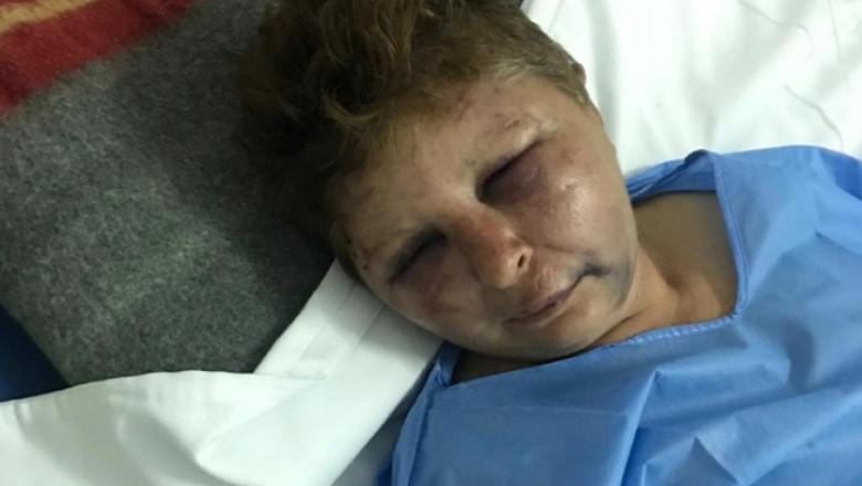 femeie batuta politist