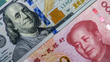 Face to face of US dollar banknote and China Yuan banknote for 2 biggest economic in the world which now United states of America and China have war trade.