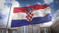 Croatia Flag 3D Rendering on Blue Sky Building Background