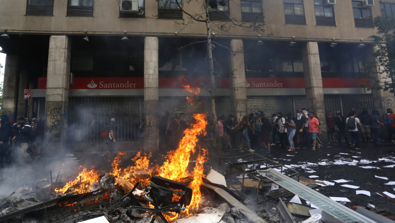 State Of Emergency Remains As Demonstrations And Looting Continues In Chile