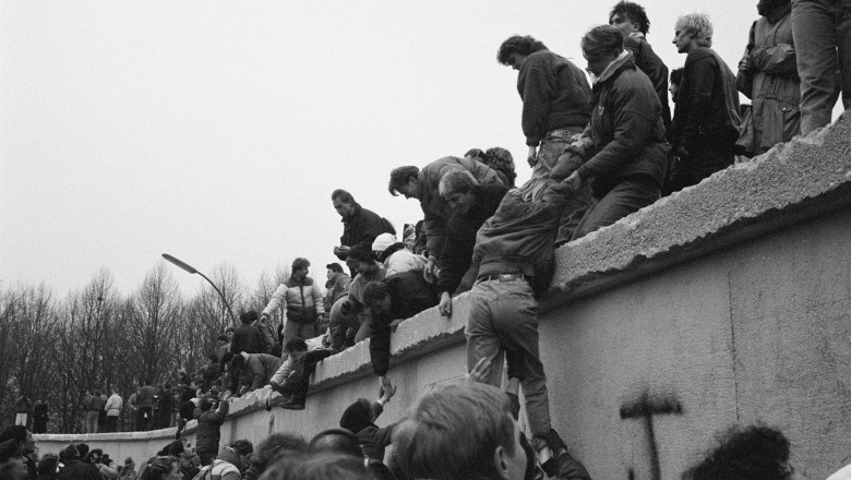 East Berliners Climb Wall