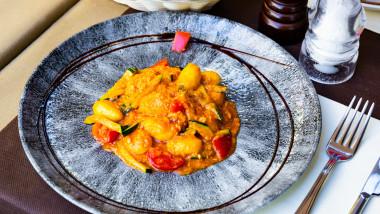 restaurant Italian gnocchi with zucchini and salmon