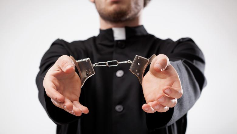 Priest handcuffed