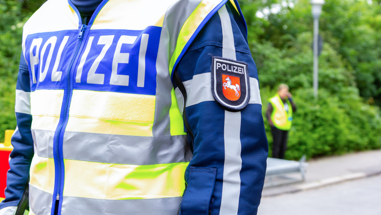 German police emblem weared by an officer. The german word Polizei, means police.