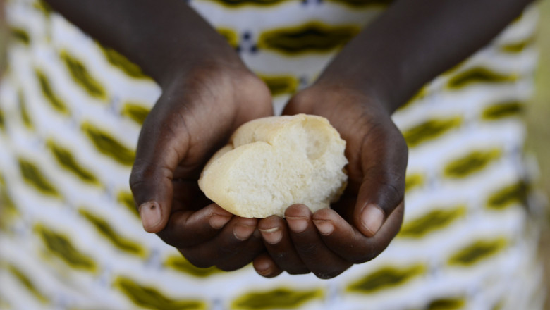 African Hands Cupped Holding Bread - Survival in Africa Symbol