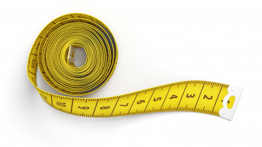 3d rendering of partly rolled out yellow measuring tape isolated on white background.