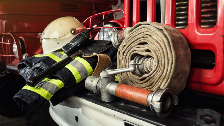 Firemen gear on firetruck such as fire barrel, special clothing, ration, helmet and hydrant