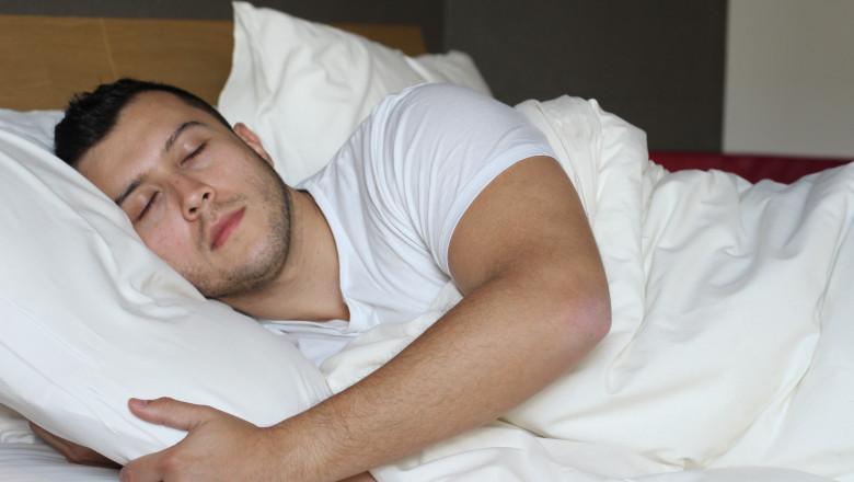 Ethnic male sleeping in comfortable position