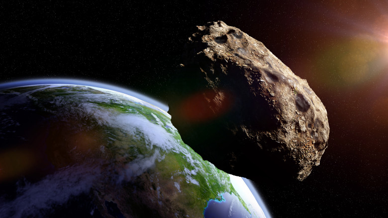 asteroid approaching planet Earth, meteorite in orbit before impact