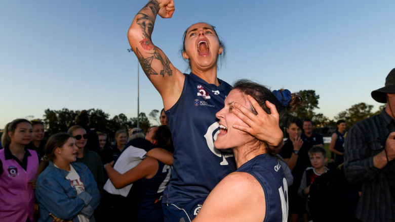 Abby Reynolds and Jessica Wuetschner of Coorparoo celebrate after their team's victory in the WQAFL Grand Final match between Bond University and Coorparoo at Leyshon Park on August 25, 2019 in Brisbane, Australia