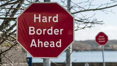 "Sign at a stop junction in Ireland saying ""Hard Border Ahead"""