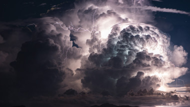 Dramatic cloud and thunderstorm over an island. Multiple Lightni