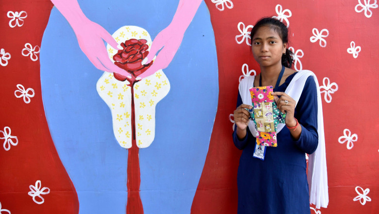 Guwahati, India. 28th May, 2019. A student of Parijat Academy holding a reusable cloth menstrual pad which made by the students of Parijat Academy as Menstrual hygiene day is observing today, in Guwahati, Assam on 28 May 2019.Parijat Academy is a school f