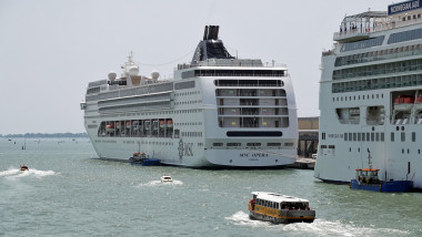 09 June 2019, Italy, Venedig: The cruise ships MSC Opera (l) and Norwegian Jade are anchored in the cruise terminal Venezia. In the foreground a launch of the Alilaguna leaves the passenger terminal. Photo: Soeren Stache/dpa-Zentralbild/ZB
