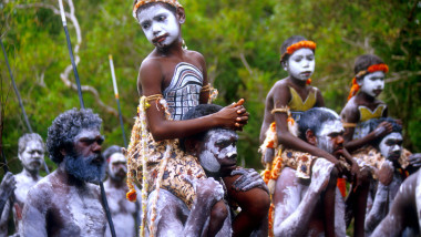 Yolngu Boy movie young aboriginal boys painted with sacred dreaming being carried to their initiation ceremony Arnhem Land