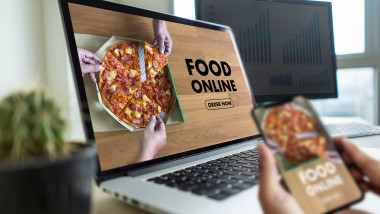 Close up woman ordering food online by internet Concept order food