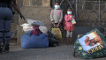 Two Kenyan child refugees evicted from Cape Town's Central Methodists Church in South Africa with hundreds of others after a six month occupation