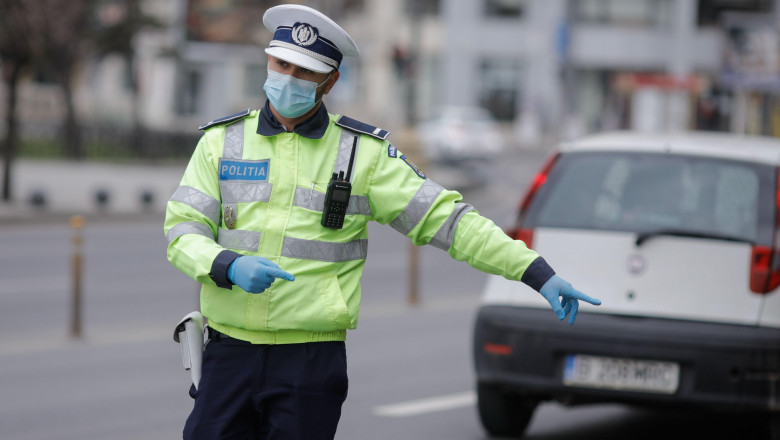 Bucharest, Romania - March 25, 2020: Romanian road police officer pulls over a car to check for the drivers identity papers.
