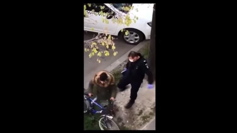 jandarm loveşte cu piciorul în fund un tânăr biciclist în Brăila, România coronavirus