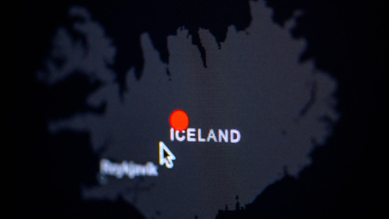 Iceland. Coronavirus COVID-19 global cases Map. Red Dot showing the number of infected. Johns Hopkins University map on monitor display.