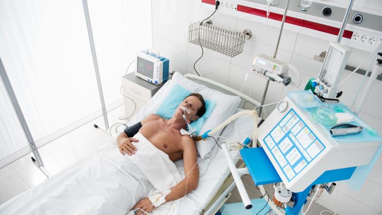 getty bărbat bolnav pat de spital