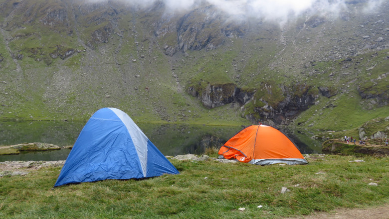 Camping at a Mountain Lake in a Misty Landscape