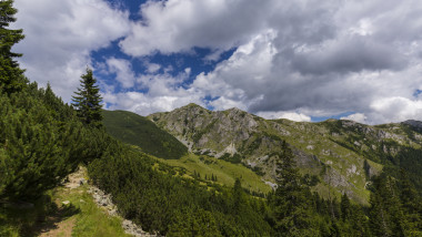 Beautiful mountain scenery in summer, with lush green foliage and rain clouds