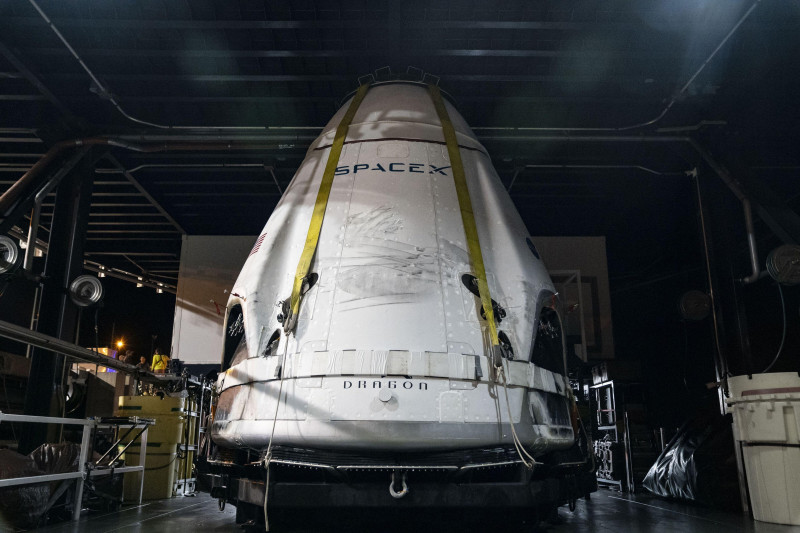 The SpaceX Crew Dragon spacecraft is offloaded from the company's recovery ship, Go Searcher, at Port Canaveral in Florida following the uncrewed In-Flight Abort Test, on January 19, 2020. SpaceX and NASA are targeting May 27 for Falcon 9's launch of Crew