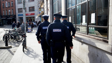three garda officers one female two male on foot patrol in the temple bar area of Dublin Republic of Ireland europe