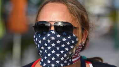 coronavirus femeia cu masca sua