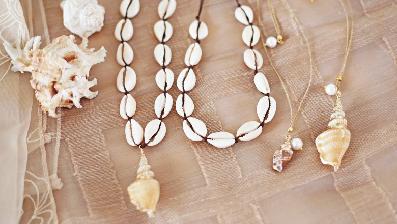 bohemian summer jewelry with shells - cowrie shells necklaces - fashion jewelry advertisement