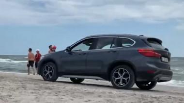 bmw masina pe plaja vadu