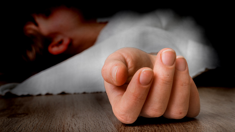 Dead woman lying on the floor under white cloth