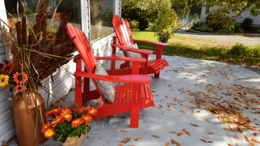 Two Red Chairs on Patio in the Autumn (New Brunswick Canada)