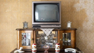 Old fashioned interior - vintage television set on stand