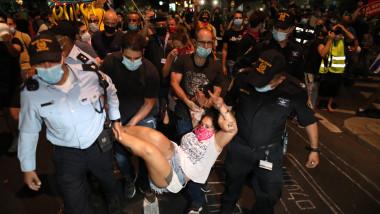 100.000 de persoane au protestat pe străzi şi în intersecţii în Israel, de sâmbătă seară.
