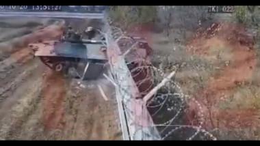 un tanc trece prin zidul aeroportului