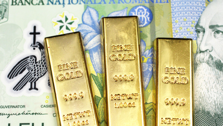 A one Romanian leu bill with three gold bars