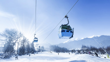 Gondola lift at ski resort in winter. Pirin Mountains. Ropeway station in Bansko